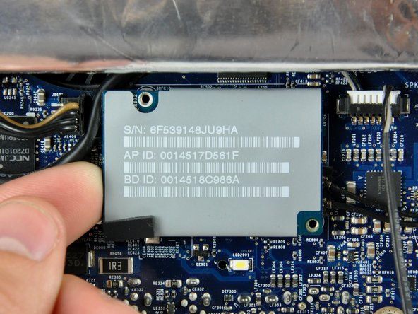 Lift the AirPort/Bluetooth board up from its left edge to separate it from its socket on the logic board.