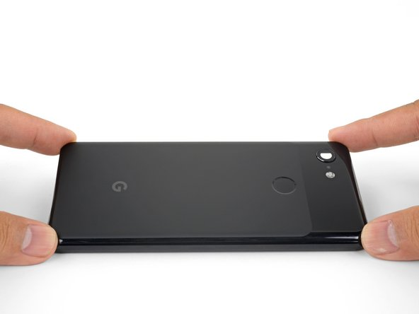 Once you have sliced around the perimeter of the phone, carefully lift the left edge of the back cover.