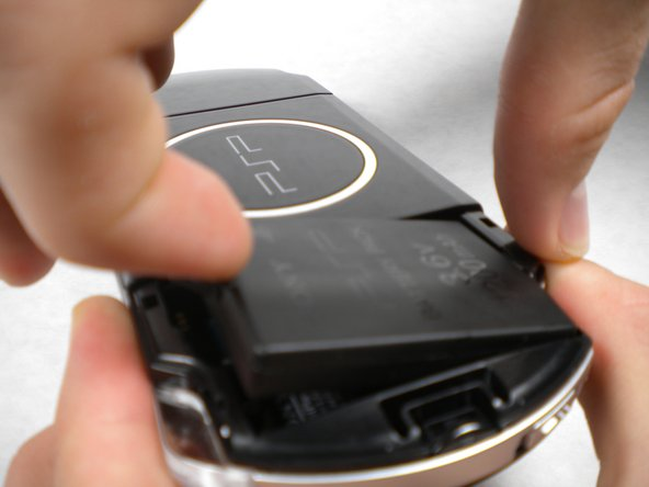Lift the battery out of the PSP.