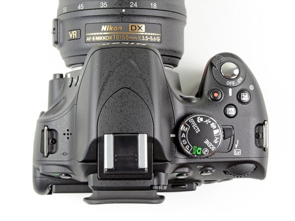 Unlike the D90, the top of the camera does not include an informational LCD. Instead, we get the rotating mode selector on the right.