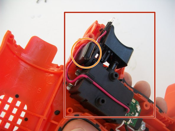 Remove the trigger chip assembly from the drill.