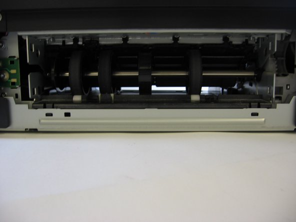 Now that the back panel of your printer has been removed, your printer should look like the printer in the picture. NOTE: remember to collect ANY and ALL screws, springs, doo-hickies, doo-dads, etc. in ONE place so that you can find and access them easily. We warned you.