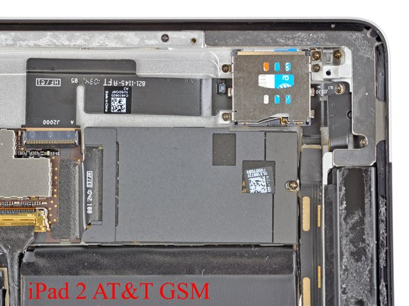 Image 1/2: The microSIM slot is located in the upper left corner of the GSM iPad 2. The case is machined uniquely in this area on GSM models to accommodate the SIM ejector mechanism and the SIM tray.
