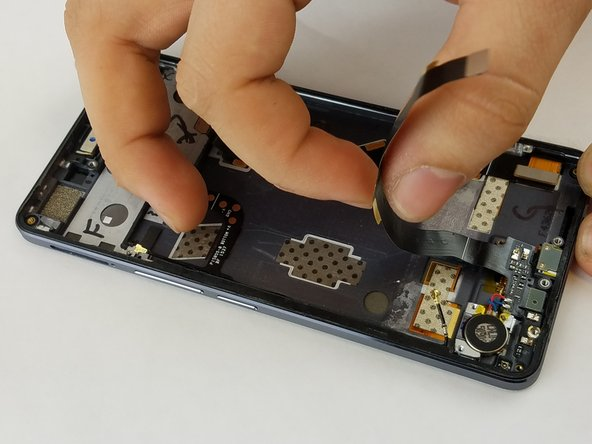 It might be helpful to bend the cable out of the way when working on the phone.