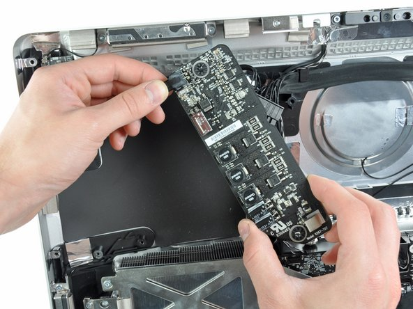 Image 3/3: Removing the power supply requires disconnecting the AC inlet cable from the logic board.