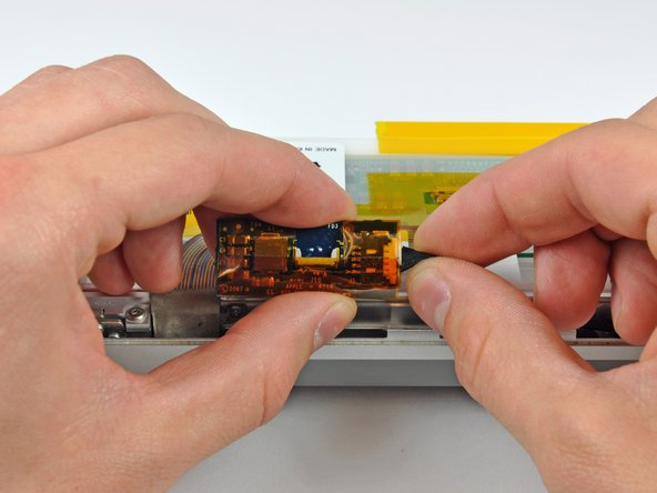 Image 1/1: Disconnect the LED driver cable by pulling its connector away from the socket on the inverter board.