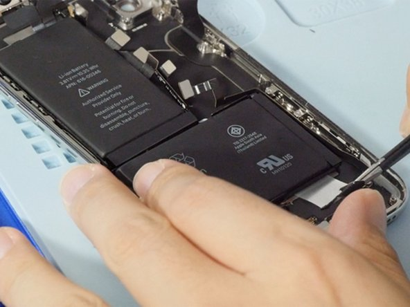 Pulling out 4 battery adhesives with a tweezers then we can remove the battery.