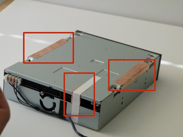 Image 1/3: Pull off the bottom metal panel of the optical drive. You will see the main circuit board underneath.