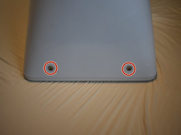 Remove two 2.5mm hex screws from each of the other sides of the computer.