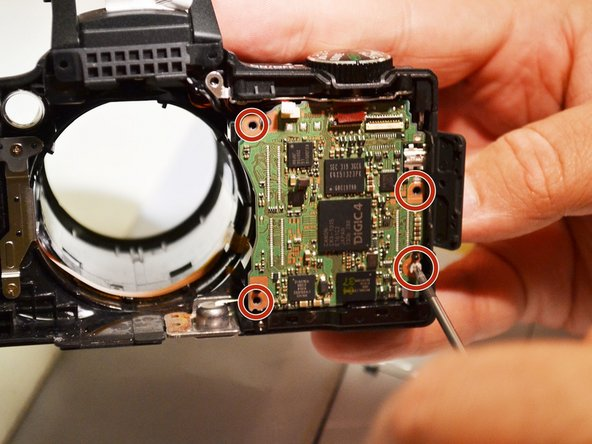 Using the Phillips 00 screwdriver, remove the 4mm screw from motherboard.