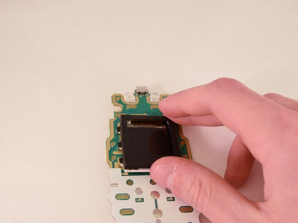 Remove the black rubber gasket that surrounds the screen from the top face of the motherboard.