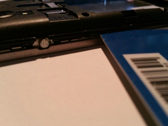 Use your plastic card to release the clips and separate the plastic cover from the metal frame.
