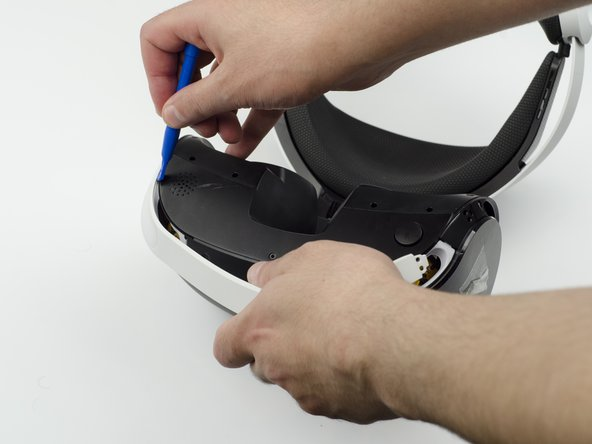 There is adhesive attaching the panel to the headset, in which case it will take more force to remove the panel.