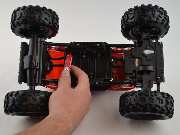 Image 1/1: Install the new batteries following the battery placement diagram engraved on the R/C truck .