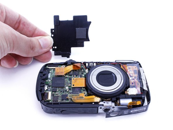 Remove two 2.4mm PH000 screws from the plate on the front of camera.