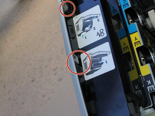 Some of these tabs are inside the printer, so you will need to open the door and look along the right side.