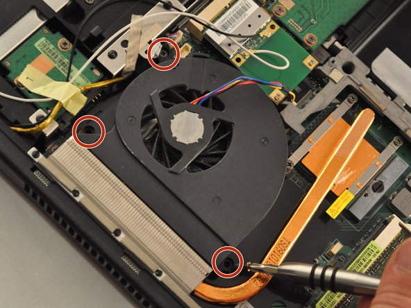 "Using the PH1 screwdriver, remove the 3 .75mm screws labeled as 1, 2, and 3 on the fan. NOTE these screws have the labels ""1"", ""2"", and ""3"" next to them."
