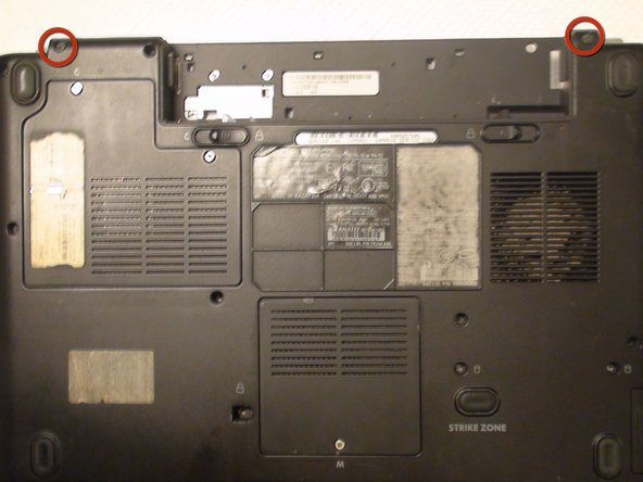 Image 1/3: Remove the two 10 mm Phillips #1 screws from the back of the laptop that also attach the lid assembly to the laptop with a Phillips #1 screwdriver.