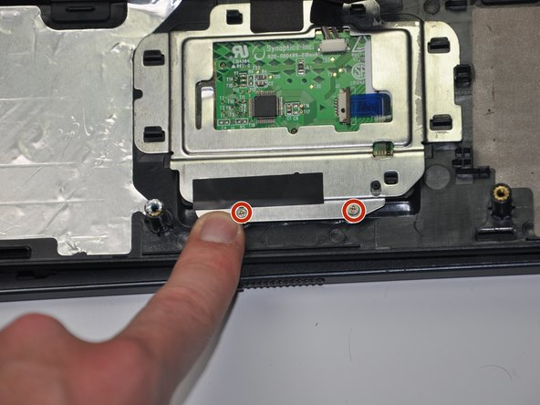 Remove the two 3.5mm Phillips #00 screws located at the bottom of the aluminum frame.