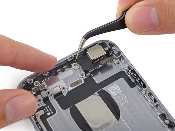 Remove any tape covering the upper left rear-facing camera screw.