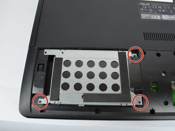 Loosen the three 5 mm screws holding down the hard drive using a Phillips #00 bit.