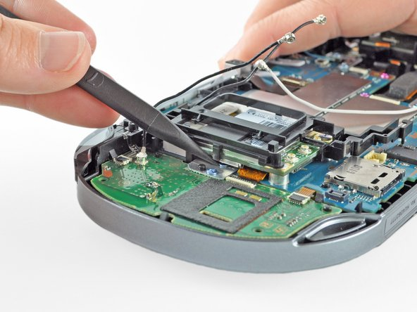 Image 1/2: Peel up and remove the wireless card casing.