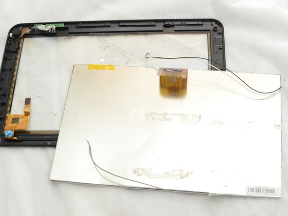 The LCD can now be removed from the plastic tablet housing.
