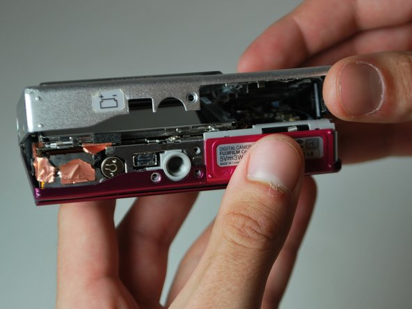 Image 1/3: There will be a ribbon cable attaching the front panel to the motherboard, be sure not to tear this.