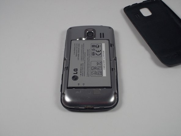 The battery will be the grey rectangular object sitting in the center of the backside. Take out the battery with your hand. Now replace it with your new baterry. Afterwards, reinsert the back cover and you will be good to go.