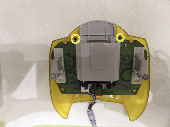 Use your #1 screwdriver to remove the 6 external screws and remove the back plate of the controller.