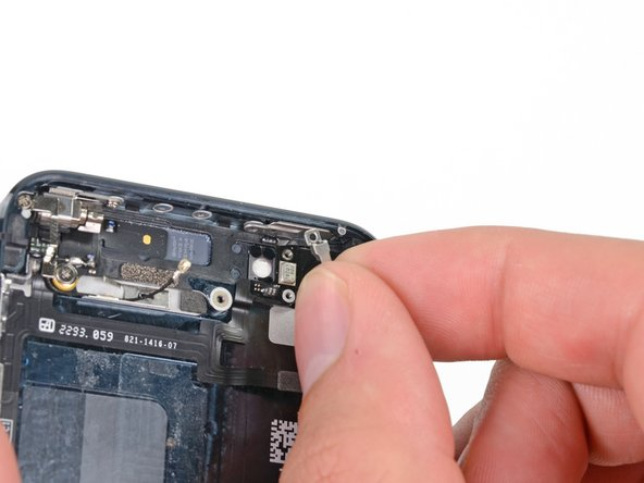 Image 1/1: Remove the metal power button bracket.