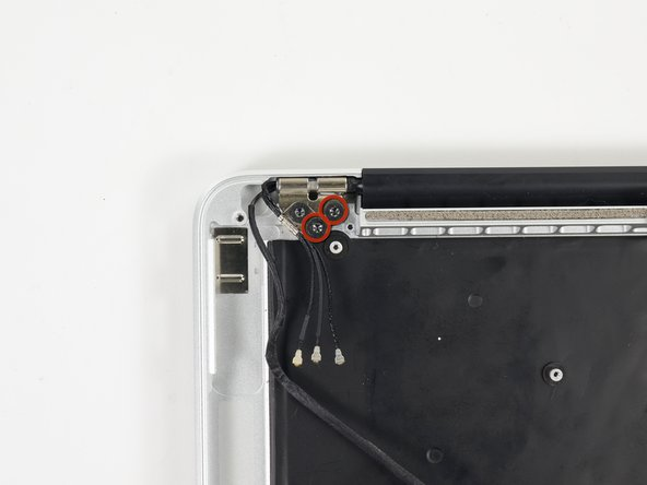 Image 1/2: Remove the four inner 5.3 mm T8 Torx screws (two on each side) securing the display to the upper case.