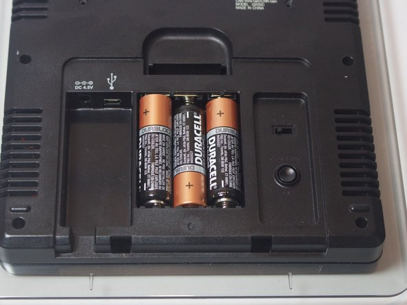 Remove the 3 x AA alkaline batteries from each  battery slot.