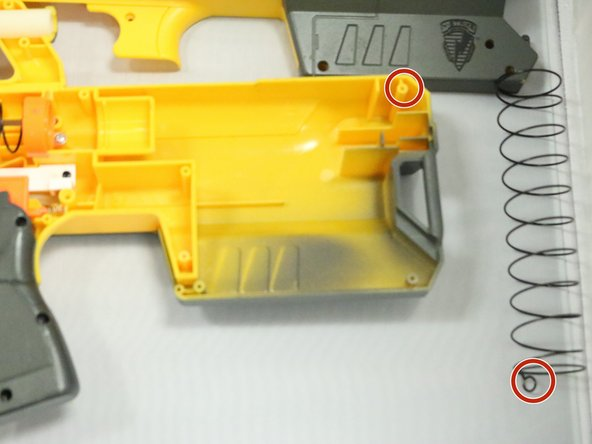 Image 1/1: Spring hook can be seen through same highlight whereas the yellow holder is located.