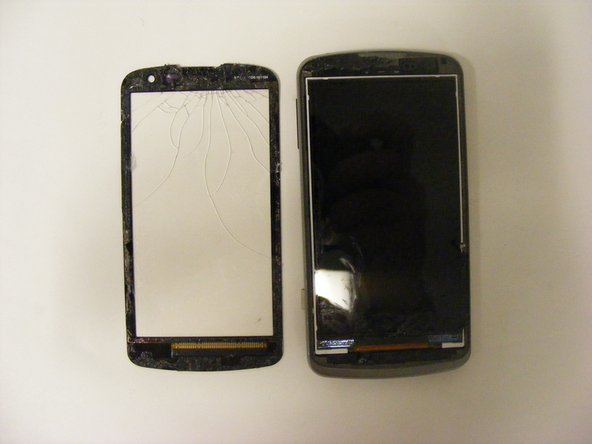 Once the screen is loosened, fully remove it from the device by peeling it away from the base of the phone.
