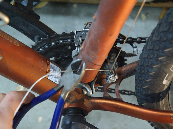 Once the derailleur is in the correct position, cut the cable to length, leaving 2 to 3 inches to allow for later adjustment if needed.