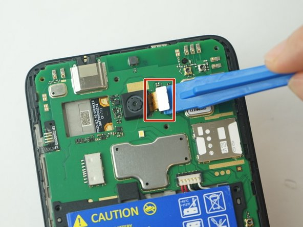 Use the Plastic Opening tools to gently dislodge the broken camera from the inside of the phone.