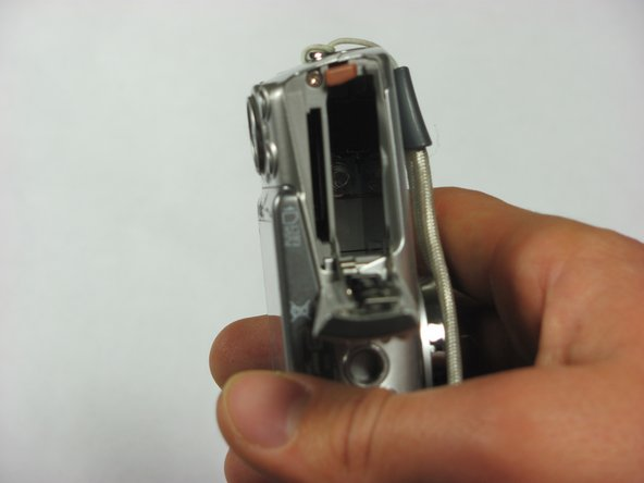 In the camera shown in the photos, there is not a Memory Card or Battery.