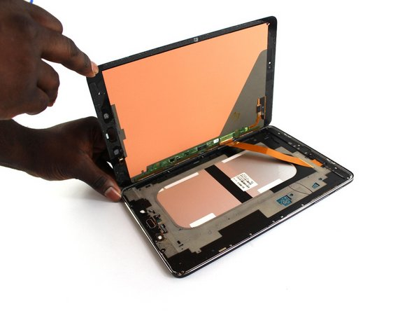 Once the screen is detached, open the tablet like a book.