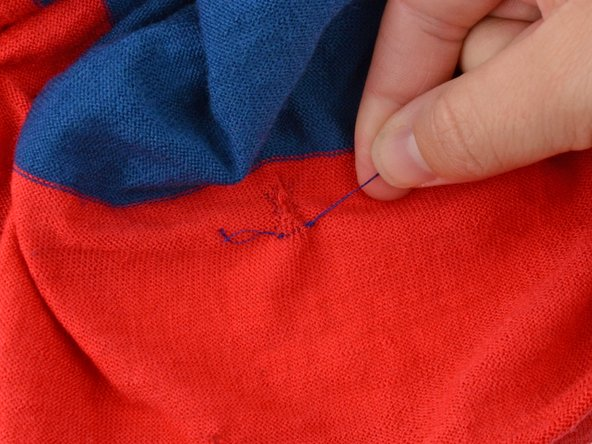 Pull the thread taut, creating a knot on top of the knot you previously made.