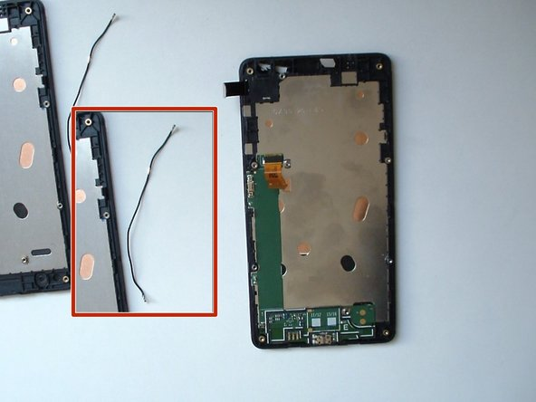 The cable is attached at several points to the frame and to the board. Gently remove it.