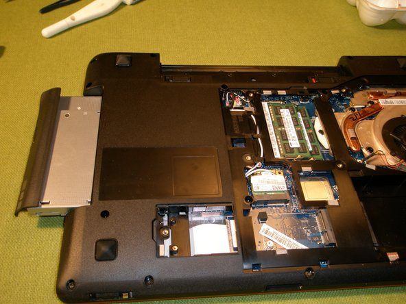 Remove the 1 retaining screw from the optical drive and slide it out of the unit.