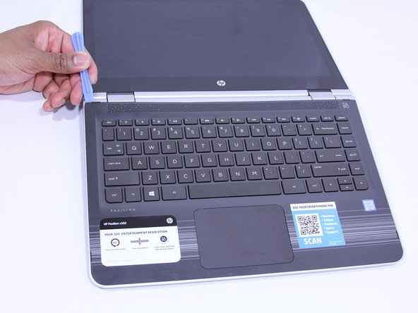 The keyboard is attached internally by clips. Use a small amount of force when removing the keyboard.