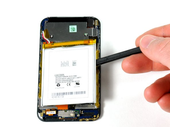 Image 1/1: The battery is glued to the iPod's display, but no screws hold it in place.
