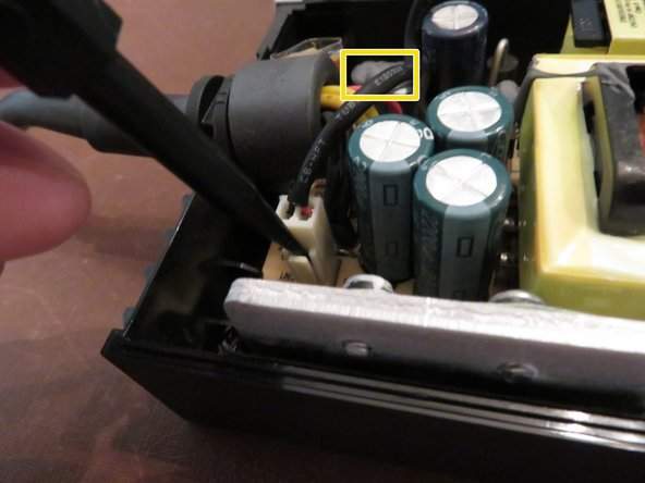 Caution: Be careful not to touch the capacitor wires as you work. If possible, use a capacitor discharge probe to safely rid the capacitors of dangerous charges.