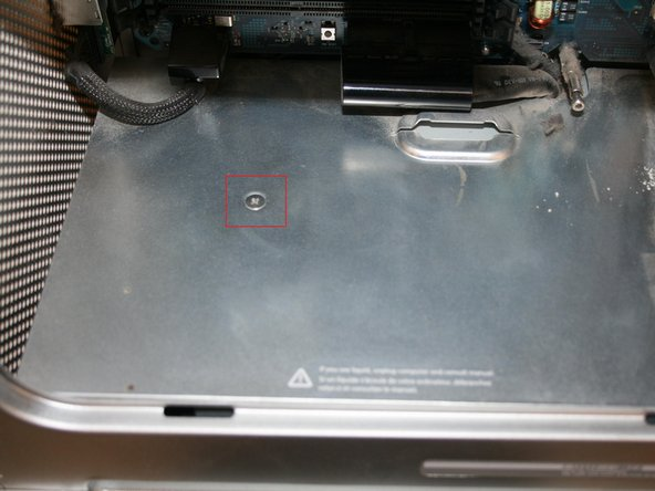 Image 1/3: Remove the bottom screws which held the processor in place (four in total). This will help to take the cover out without damaging the motherboard