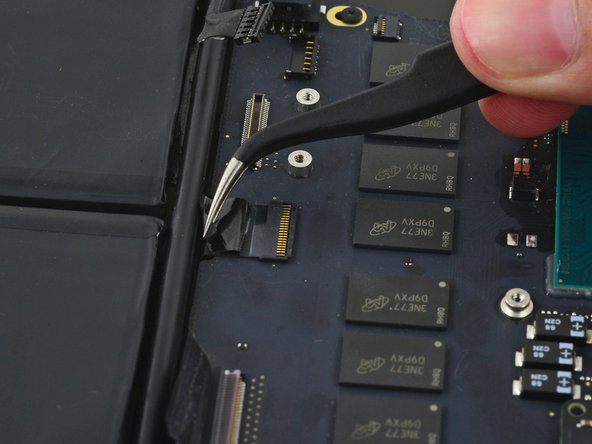 If necessary, peel back any tape covering the trackpad cable connector.