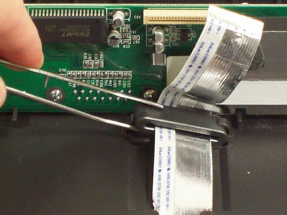 Remove the metal housing for the ribbon cable at the base of the scanner.