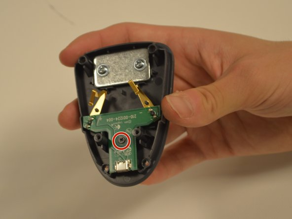 Use the Phillips #0 screwdriver to remove the last (4mm) screw. The motherboard can now be removed.