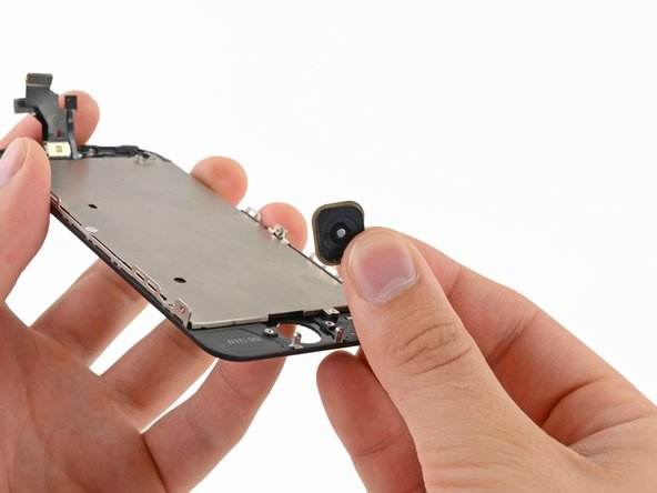 Image 1/1: Remove the home button from the display assembly.